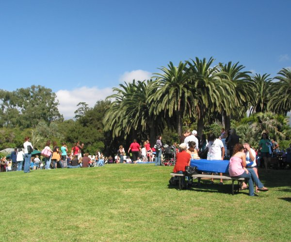 A large gathering on the lawn at the top of the zoo.