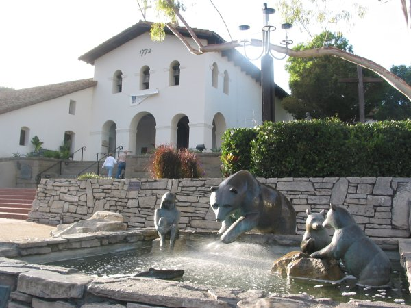 Statue of bears and a Chumash indian hunting for salmon, in front of the mission. San Luis Obispo used to be an area with an abundance of bears.
