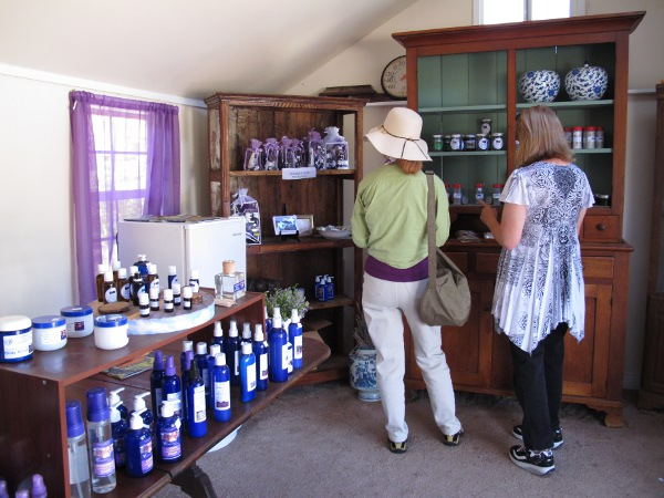 Ladies choosing some lavender lotion.