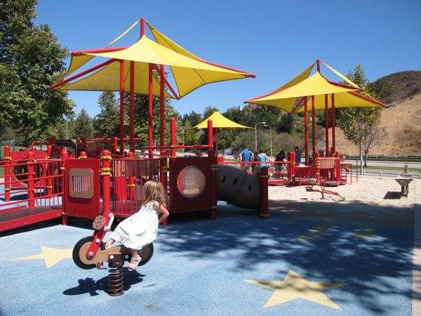 Bike bouncy, tunnel, chimes, sand station.