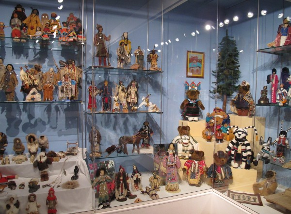 Display case with Native American dolls.