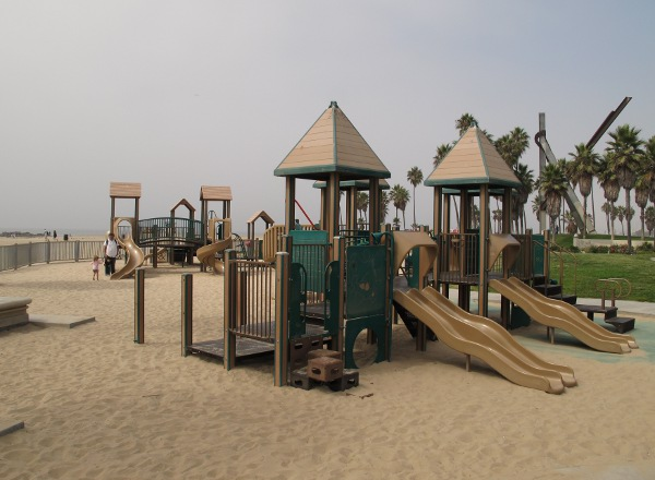 Toddler and big kid playground in the sand at Venice Beach.