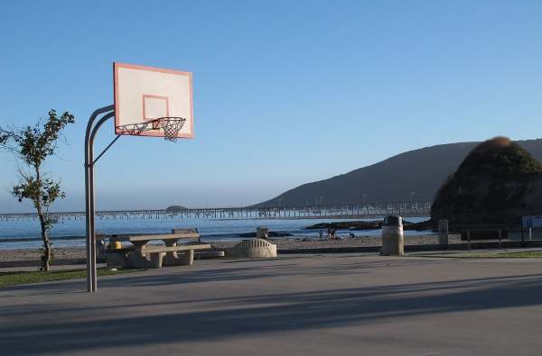 Basketball court by the playground, with view of the sea!