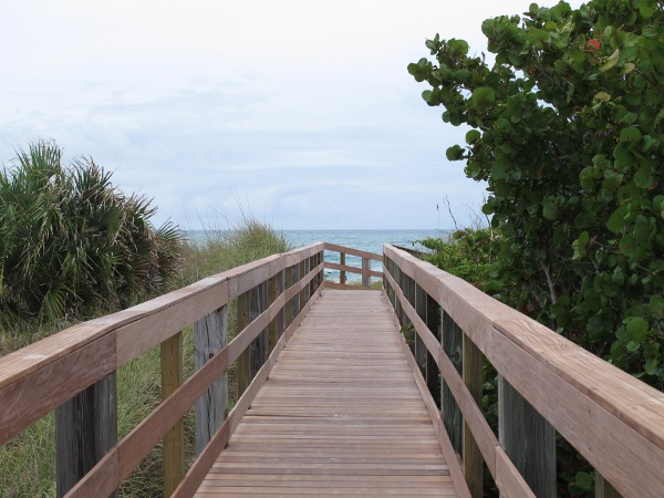 Wooden walkway to the sand.