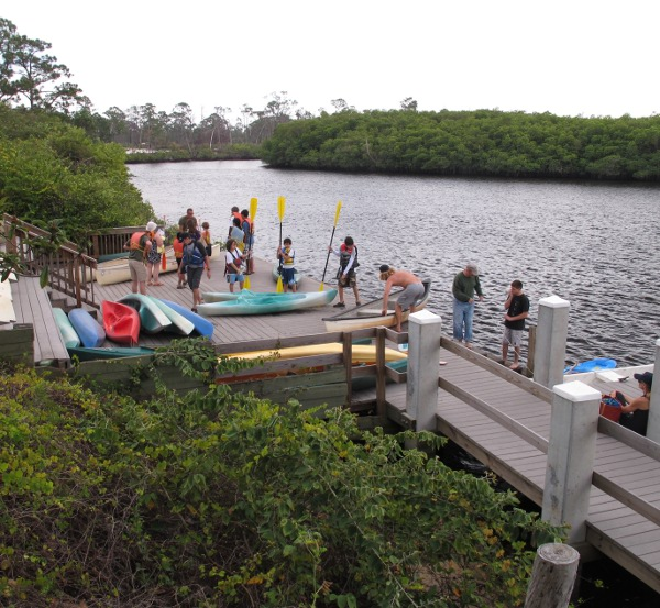 A group prepares to paddle.