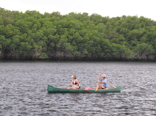 A couple returning from their paddle.