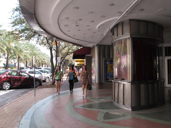 Three women walk along the Miracle Mile.