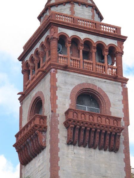 Carved wood details on tower.